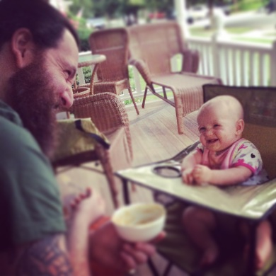 Hubs and Miss Hazel celebrating the ease of outdoor meals in the Ciao Baby portable high chair.